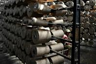Also known as sack cloth, hessian, or burlap, jute is hailed by environmentalists because growing it can help with carbon capture, and it uses less natural resources than cotton (AFP/Dibyangshu SARKAR)