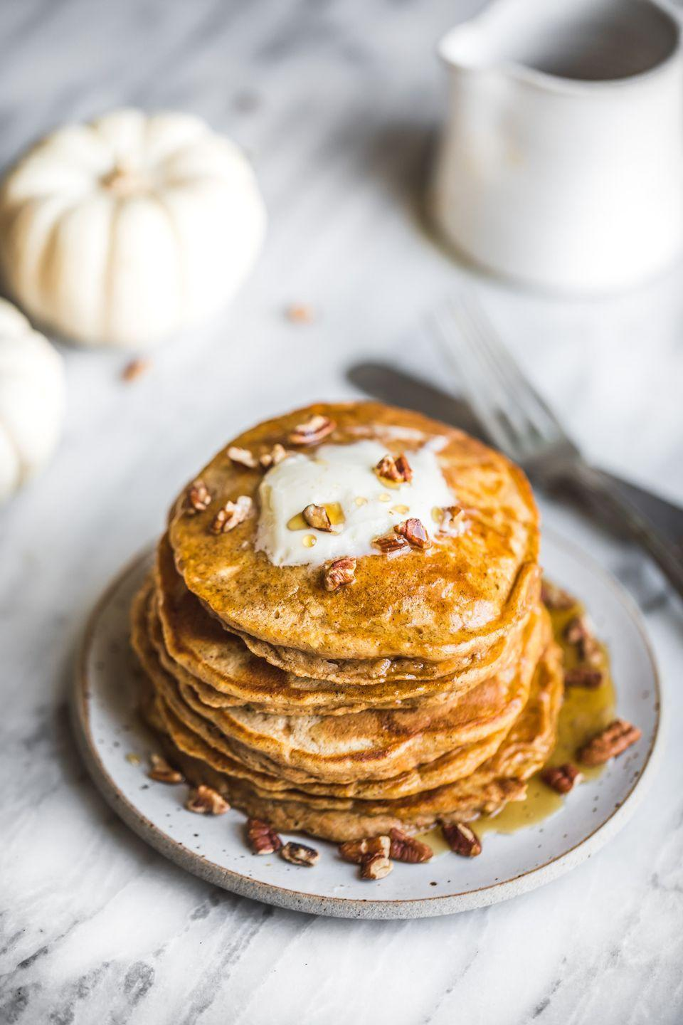 """<p>Sweeten up your morning with these flapjacks. A pat of putter, a sprinkle of pecans, and a drizzle of maple syrup is a yummy finish to this sweet potato recipe.</p><p><strong>Get the recipe at <a href=""""https://www.ambitiouskitchen.com/chai-spiced-sweet-potato-pancakes/"""" rel=""""nofollow noopener"""" target=""""_blank"""" data-ylk=""""slk:Ambitious Kitchen"""" class=""""link rapid-noclick-resp"""">Ambitious Kitchen</a>.</strong></p>"""