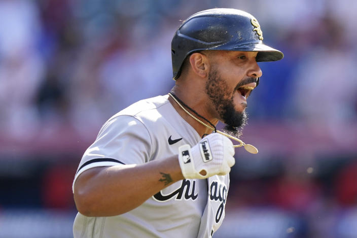 Chicago White Sox's Jose Abreu reacts after hitting a sacrifice fly in the eighth inning of the first baseball game of a doubleheader against the Cleveland Indians, Monday, May 31, 2021, in Cleveland. White Sox's Billy Hamilton scored on the play. (AP Photo/Tony Dejak)