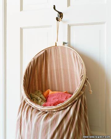 """<div class=""""caption-credit""""> Photo by: Martha Stewart Living</div><b>Ever-Open Laundry Bag</b> <br> A hanging laundry bag saves floor space, but you have to wrestle with the drawstring to deposit dirty clothes. Have it both ways when you prop open the suspended bag with a large embroidery hoop at least 14 inches in diameter. <br> <b>Related:</b> <br> <b><a href=""""http://www.marthastewart.com/275539/bedroom-decorating-ideas/@center/277006/bedroom-and-bathroom-decorating?xsc=synd_yshine"""" rel=""""nofollow noopener"""" target=""""_blank"""" data-ylk=""""slk:23 Ways to Decorate Your Bedroom"""" class=""""link rapid-noclick-resp"""">23 Ways to Decorate Your Bedroom</a> <br> <a href=""""http://www.marthastewart.com/275280/bathroom-organization-tips/@center/277006/bedroom-and-bathroom-decorating?xsc=synd_yshine"""" rel=""""nofollow noopener"""" target=""""_blank"""" data-ylk=""""slk:24 Ways to Organize Your Bathroom"""" class=""""link rapid-noclick-resp"""">24 Ways to Organize Your Bathroom</a></b> <br>"""