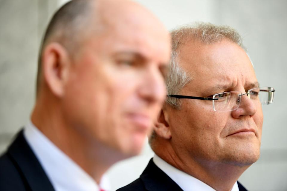 """CANBERRA, AUSTRALIA - NOVEMBER 25: Prime Minister Scott Morrison and Minister for Government Services Stuart Robert (L) speak to media during a press conference at Parliament House on November 25, 2019 in Canberra, Australia. Australian spy agency ASIO is investigating reports China tried to plant an operative as an MP in a seat in Federal Parliament. Fairfax Media and Channel Nine's 60 Minutes reported over the weekend that Chinese intelligence agents offered a million dollars to pay for the political campaign of Liberal Party member Bo """"Nick"""" Zhao, to run for a Melbourne seat. Nick Zhao was found dead in a Melbourne hotel room shortly after approaching ASIO about the offer, with his cause of death still unknown. (Photo by Tracey Nearmy/Getty Images)"""