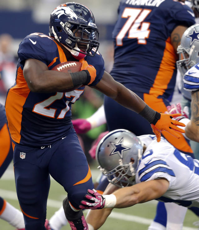 Denver Broncos running back Knowshon Moreno, left, gets past Dallas Cowboys defensive tackle Nick Hayden, bottom right, during the second quarter of an NFL football game Sunday, Oct. 6, 2013, in Arlington, Texas. (AP Photo/Sharon Ellman)