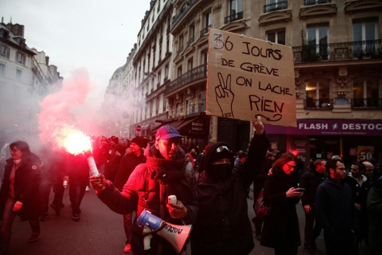 Tensions flared in Paris and other cities as some black-clad protesters smashed glass-panelled shopfronts and bus stops (AFP Photo/Abdulmonam EASSA)