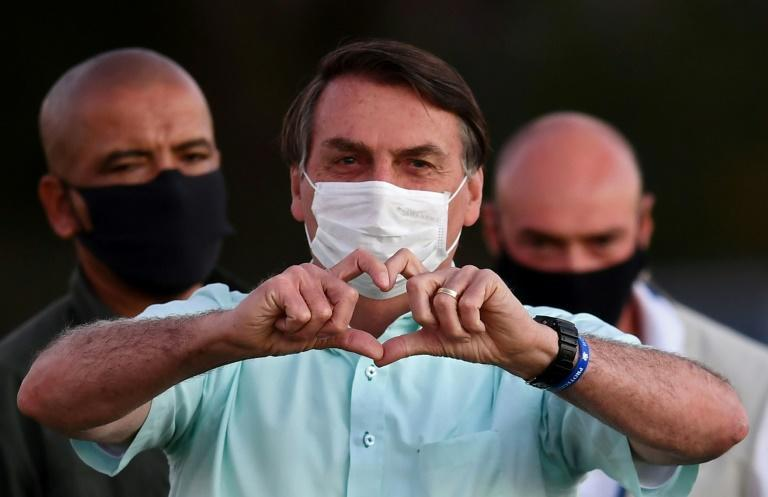 Brazilian President Jair Bolsonaro greets supporters in the garden of the Alvorada Palace in Brasilia, on July 22, 2020