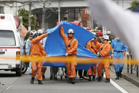 Rescue workers operate at the site where sixteen people were injured in a suspected stabbing by a man, in Kawasaki, Japan May 28, 2019. in this photo released by Kyodo. Mandatory credit Kyodo/via REUTERS