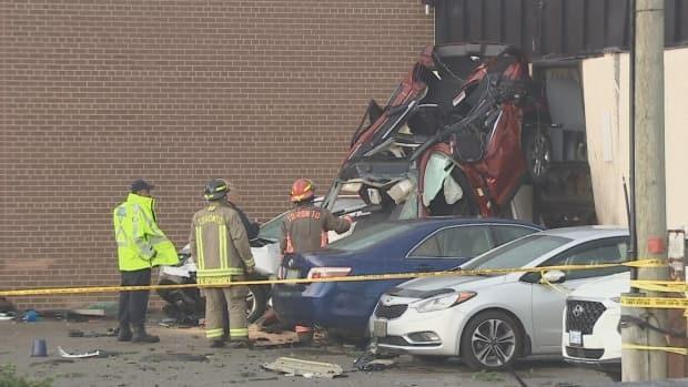 Emergency crews were called just before 4:15 p.m. to Carlingview Drive and Constellation Court, where two people were trapped inside a vehicle. (CBC - image credit)