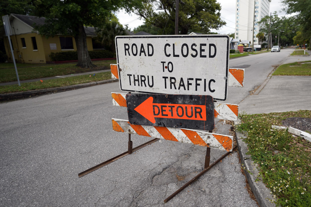 A city street is closed for repairs and upgrades,Thursday, April 1, 2021, in Orlando, Fla. As part of an infrastructure proposal by the Biden administration, $115 billion is earmarked to modernize the bridges, highways and roads that are in the worst shape. (AP Photo/John Raoux)
