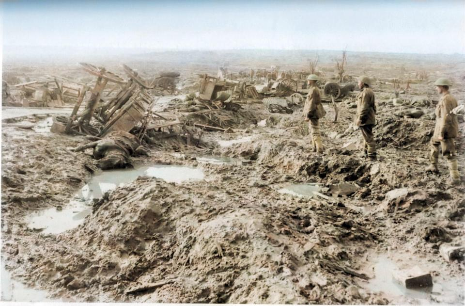 <p>A trio of soldiers look out solemnly at the destruction of the battlefield (Royston Leonard / Media Drum World / Caters News) </p>