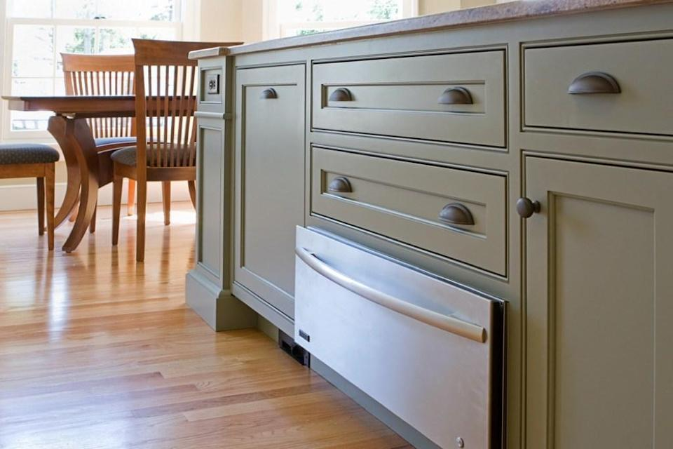 It may be great for storing baking plans and stray pot lids, but you could be doing so much more with that drawer under your oven. That space, depending on whether it's a warming drawer or broiler, can help you keep a dish hot while you wait for the rest of your food to cook. Or, it can help melt, brown, or caramelize your dish.