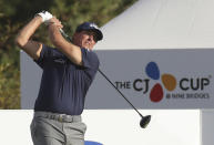 Phil Mickelson of the United States watches his shot on the 10th hole during the first round of the CJ Cup PGA golf tournament at Nine Bridges on Jeju Island, South Korea, Thursday, Oct. 17, 2019.(Park Ji-ho/Yonhap via AP)