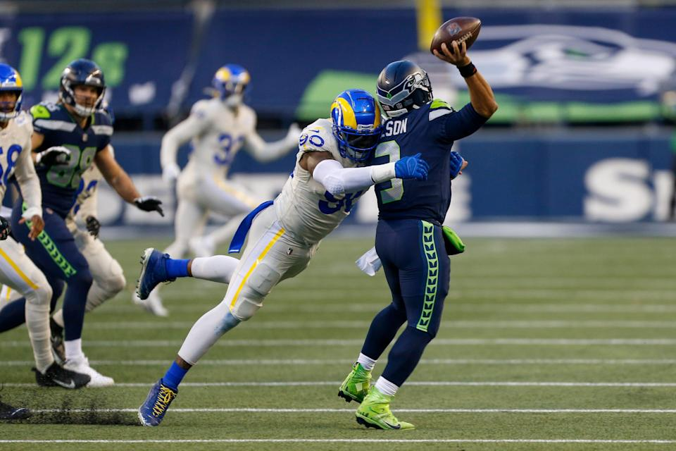 Los Angeles Rams defensive end Michael Brockers pressures Seattle Seahawks quarterback Russell Wilson during a playoff game Jan. 9, 2021 in Seattle.