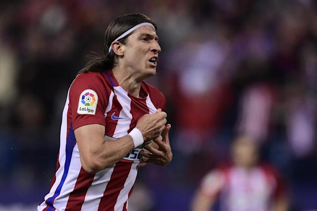Atletico Madrid's defender Filipe Luis celebrates after scoring during the Spanish league football match Club Atletico de Madrid vs Real Sociedad at the Vicente Calderon stadium in Madrid on April 4, 2017 (AFP Photo/JAVIER SORIANO)