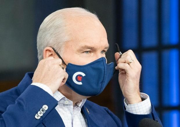 Conservative Leader Erin O'Toole takes off his mask before speaking to the media in Ottawa on Tuesday September 7, 2021. (Frank Gunn/Canadian Press - image credit)