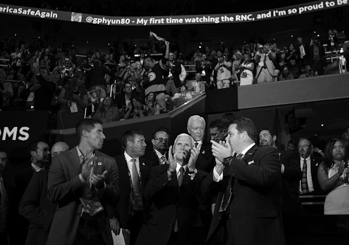 <p>Indiana Gov. Mike Pence claps while listening to speakers at the Republican National Convention. (Photo: Khue Bui for Yahoo News)</p>