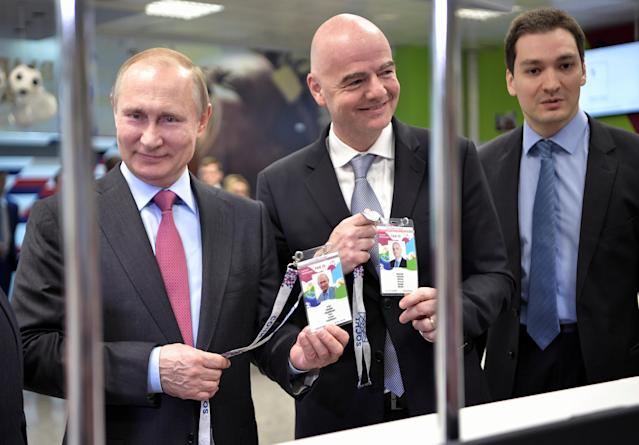 Russian President Vladimir Putin (L) and FIFA President Gianni Infantino (C) visit a 2018 FIFA World Cup FAN ID distribution centre in Sochi, Russia May 3, 2018. Sputnik/Aleksey Nikolskyi/Kremlin via REUTERS ATTENTION EDITORS - THIS IMAGE WAS PROVIDED BY A THIRD PARTY.