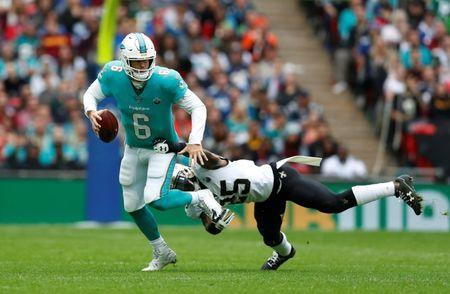 NFL Football - Miami Dolphins vs New Orleans Saints - NFL International Series - Wembley Stadium, London, Britain - October 1, 2017 Jay Cutler of the Miami Dolphins and Rafael Bush of the New Orleans Saints in action Action Images via Reuters/Matthew Childs