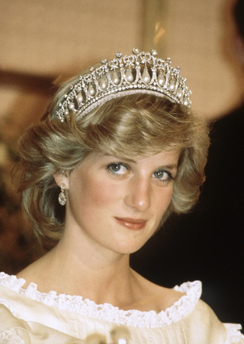 AUKLAND, NEW ZEALAND - APRIL 29: Diana, Princess of Wales wears the Cambridge Lover's Knot tiara (Queen Mary's Tiara) and diamond earrings during a banquet on April 29, 1983 in Aukland, New Zealand. Catherine, Duchess of Cambridge wore the same tiara at a diplomatic reception at Buckingham Palace in December 2015. (Photo by Anwar Hussein/Getty Images)