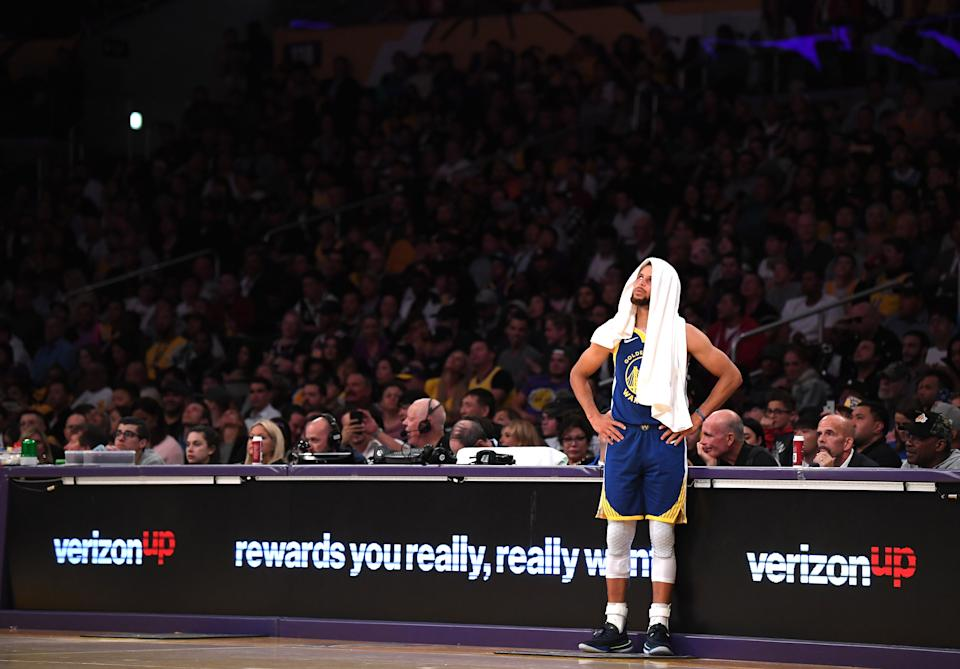 LOS ANGELES, CALIFORNIA - OCTOBER 14:  Stephen Curry #30 of the Golden State Warriors waits to check back into the game during the first half against the Los Angeles Lakers at Staples Center on October 14, 2019 in Los Angeles, California. (Photo by Harry How/Getty Images)