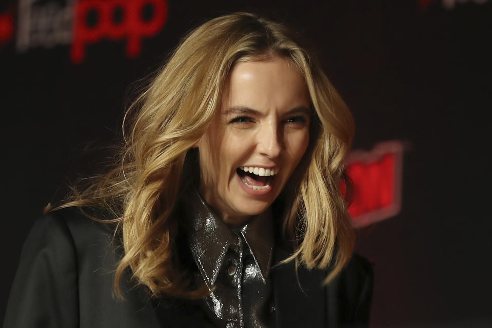 """Jodie Comer walks on stage during the 20th Century Fox Panel: An Insider's Look at """"The King's Man"""" and """"Free Guy"""" on the first day of New York Comic Con, Thursday, Oct. 3, 2019, in New York. (AP Photo/Steve Luciano)"""