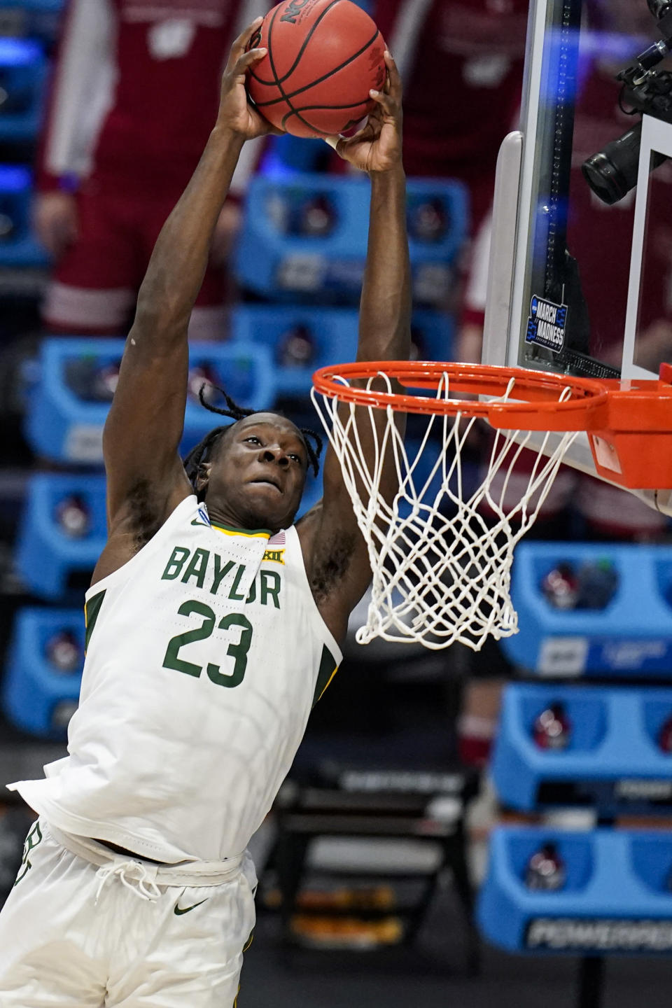 FILE - Baylor forward Jonathan Tchamwa Tchatchoua (23) goes up for a dunk against Wisconsin in the first half of a second-round game in the NCAA men's college basketball tournament at Hinkle Fieldhouse in Indianapolis, in this Sunday, March 21, 2021, file photo. All-American junior Jared Butler and his backcourt mates Davion Mitchell and MaCio Teague pretty much get all of the attention for the top-seeded Bears (26-2), who play a former Southwest Conference rival in the first national semifinal game Saturday. But those guards know they wouldn't be where they are now without the often interchangeable 245-pound post players _ the 6-foot-10 Thamba and and 6-8 Tchamwa Tchatchoua. (AP Photo/Michael Conroy, File)