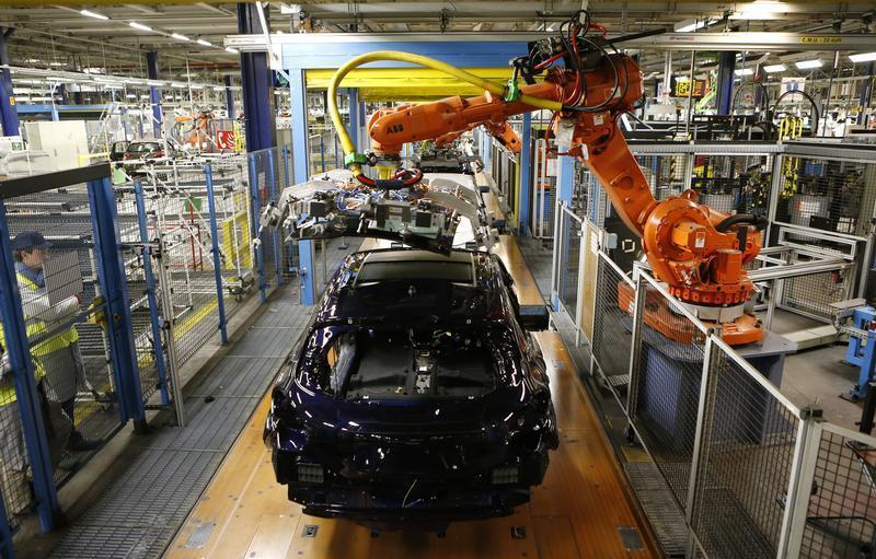 Peugeot 208 are seen at the assembly line at the PSA-Peugeot Citroen plant in Poissy