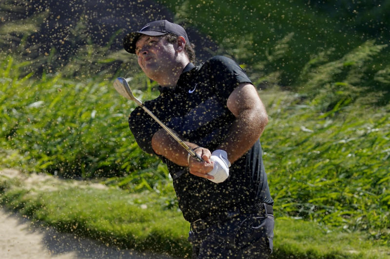 Patrick Reed hits out of the 11th green bunker during final round of the Tournament of Champions golf event, Sunday, Jan. 5, 2020, at Kapalua Plantation Course in Kapalua, Hawaii. (AP Photo/Matt York)