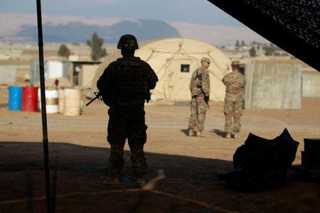 File photo: A U.S. soldier from the 2nd Brigade, 82nd Airborne Division stands guard at a military base north of Mosul, Iraq