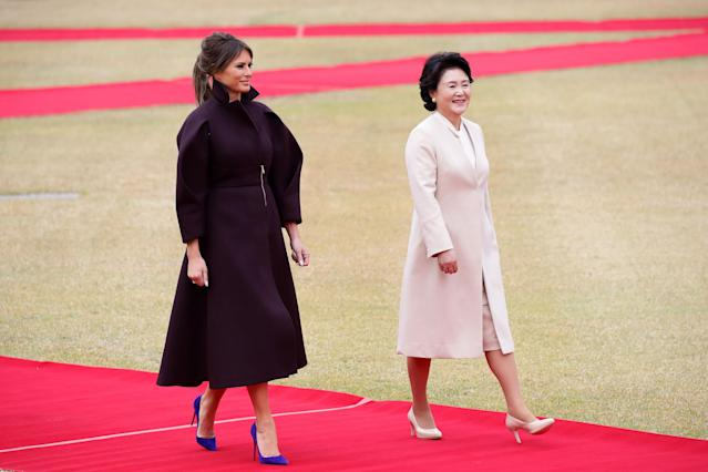 <p>For the Trump trip to South Korea, Melania chose to wear a headline-grabbing maroon coat by Emilio Pucci. <em>[Photo: Getty]</em> </p>