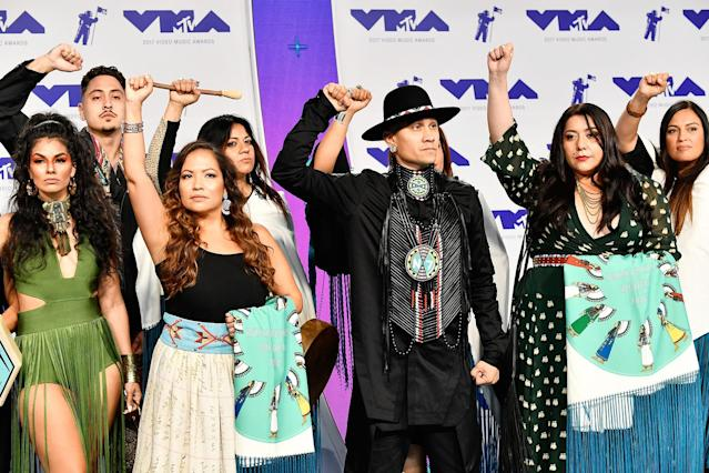 <p>Taboo of Black Eyed Peas, center, at the VMAs. (Photo: Frazer Harrison/Getty Images) </p>