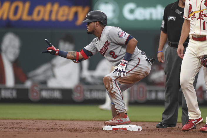 Minnesota Twins' Luis Arraez reacts after hitting an RBI-double during the third inning of a baseball game against the St. Louis Cardinals on Saturday, July 31, 2021, in St. Louis. (AP Photo/Joe Puetz)