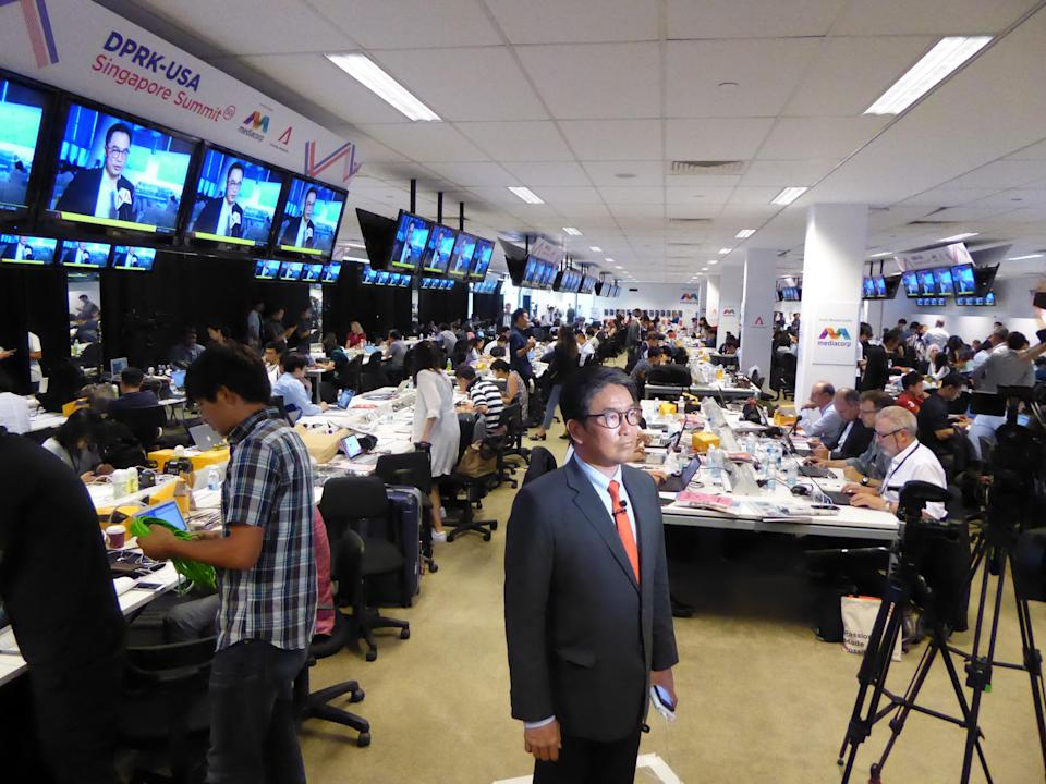 Martin Soong, co-anchor of CNBC's Street Signs, prepares to file a 'live' cross at the International Media Centre at the F1 Pit Building in Singapore on 11 June 2018. PHOTO: Nicholas Yong/Yahoo News Singapore