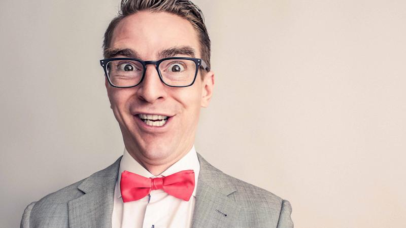 Man with a quirky smile and wearing red bowtie