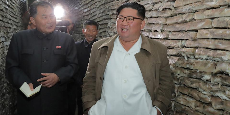 North Korean leader Kim Jong Un visits a fish processing facility in North Korea, in this undated picture released by North Korea's Central News Agency (KCNA) on November 18, 2019. KCNA via REUTERS