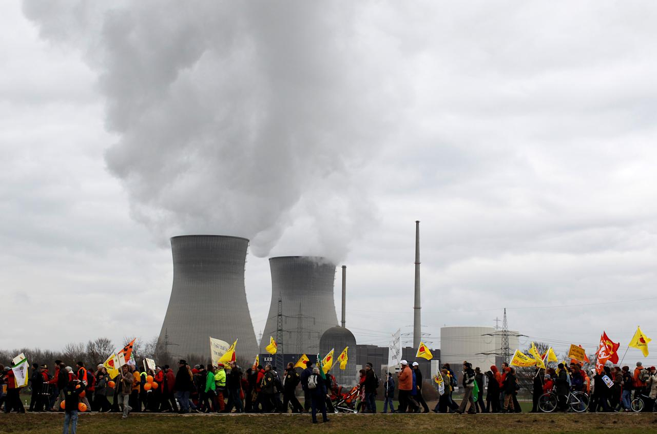 Protesters walk during an anti-nuclear rally in front of the nuclear power plant Gundremmingen March 11, 2012, to mark the first anniversary of Japan's earthquake and tsunami that killed thousands and set off a nuclear crisis.    REUTERS/Michaela Rehle/File Photo