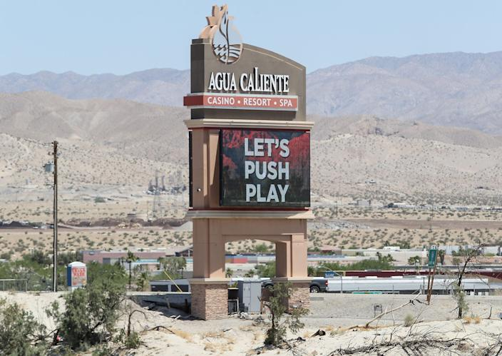 A large billboard advertises the reopening of the Agua Caliente Resort Casino and Spa in Rancho Mirage, May 22, 2020.