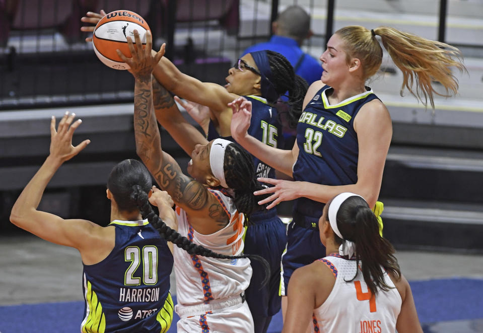 Connecticut Sun forward Emma Cannon battles Dallas Wings guard Alisha Gray, and forwards Isabelle Harrison (20) and Bella Alaire (32) for a rebound during a WNBA basketball game Tuesday, June 22, 2021 at Mohegan Sun Arena in Uncasville, Conn. (Sean D. Elliot/The Day via AP)