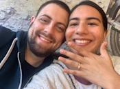 <p><strong>Names:</strong> Michelle & Jason</p> <p><strong>Ages:</strong> 29 & 27<br> <strong>Location:</strong> Sunnyside, New York<br> <strong>Submitted By: </strong>Michelle </p> <p> <br> Our love in the pandemic was more an evolution from casual dating to building a life together.<br> <br> The pandemic wasn't just the danger outside but a very present addition to our relationship. In the past year, we both started jobs at the Department of Health. Every conversation we had, professional and casual, was framed in terms of the pandemic. With stay-at-home orders put in place, our usual date nights of fun banter over cocktails were replaced with serious late-night talks on the couch about healthcare, race and equity.<br> <br> These tense conversations as the pandemic wore on went from insular anecdotal discussions of our lived experiences and grew to more thoughtful and real reflections of how we would raise our future children. Coming from different backgrounds: I'm Latina and he's white; I'm a liberal Queens girl, and he's a mountain boy from Denver. Somehow we found common ground. We balanced each other in a way that New York City made me intense and the Rocky Mountains made him calm. In October, he proposed and I said yes. <br> <br> The pandemic still governs our days but we have found ways to make happy memories alongside it. As health workers, we were able to get our first dose of Moderna's COVID-19 vaccine sitting next to each other, chatting with the vaccinators about our Fall micro-wedding; followed by a kiss as they filled out our vaccination cards. Our second dose is on Valentine's Day. </p>