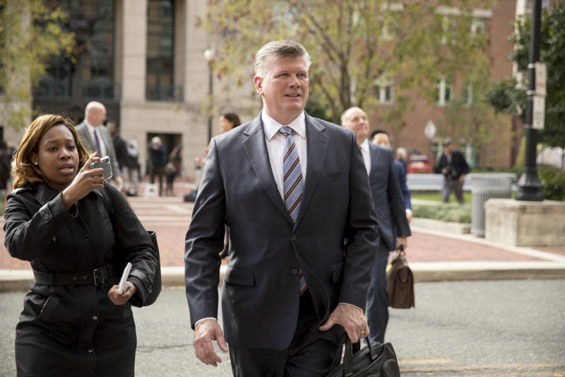 Members of the defense team for Paul Manafort, Kevin Downing, center, and Thomas Zehnle, center right, depart the federal court following a hearing in the criminal case against former Trump campaign chairman Paul Manafort in Alexandria, Va., Friday, Oct. 19, 2018. (AP Photo/Andrew Harnik)