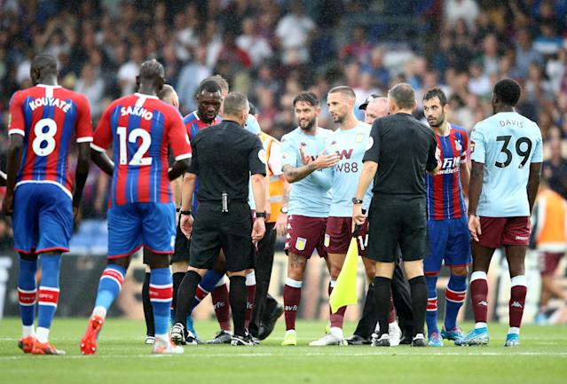 Conor Hourihane and Henri Lansbury of Aston Villa speaks to match referee Kevin Friend following the Premier League match between Crystal Palace and Aston Villa (Picture: Getty)