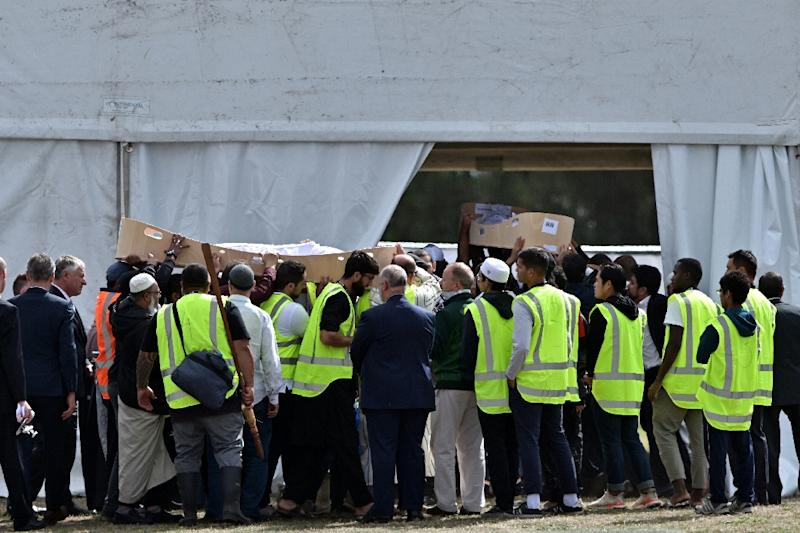 "Erdogan's office said the president was ""responding to the so-called 'manifesto'"" of the gunman who opened fire on two mosques in Christchurch during Friday prayers (victims' coffins pictured) (AFP Photo/Anthony WALLACE)"