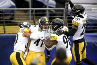 Pittsburgh Steelers linebacker Robert Spillane, second from left, celebrates with teammates after after scoring on an interception of a pass from Baltimore Ravens quarterback Lamar Jackson, not visible, during the first half of an NFL football game, Sunday, Nov. 1, 2020, in Baltimore. (AP Photo/Nick Wass)