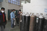 Hospital staff checks oxygen cylinders after a leakage in a oxygen plant in Nashik, in the Indian state of Maharashtra, Wednesday, April 21, 2021. A local administrator in western India says 22 patients have died in a hospital when their oxygen supply was interrupted by a leakage in a supply tank. The official says the oxygen supply has since been resumed to other patients. (AP Photo)