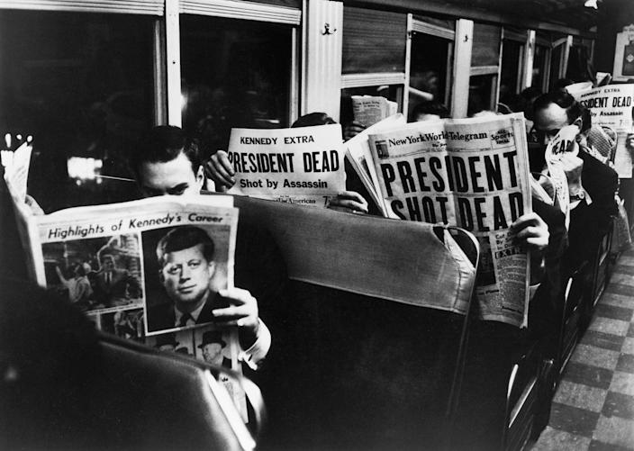 Commuters in New York read of John F. Kennedy's assassination, Nov. 22, 1963. (Photo: Carl Mydans/The LIFE Picture Collection/Getty Images)