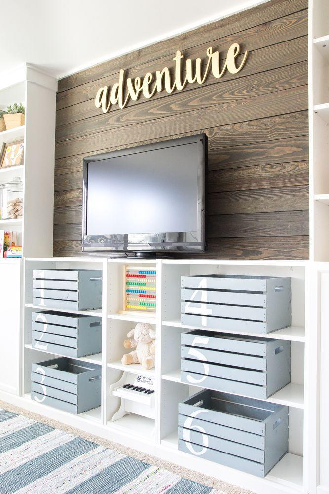 """<p>Make clean-up time a cinch by assigning every type of toy to a numbered bin in the playroom.</p><p><strong>See more at </strong><strong><a href=""""https://www.blesserhouse.com/eclectic-farmhouse-playroom-reveal-orc-week-6/"""" rel=""""nofollow noopener"""" target=""""_blank"""" data-ylk=""""slk:Bless'er House"""" class=""""link rapid-noclick-resp"""">Bless'er House</a>.</strong></p><p><strong><strong><strong><a class=""""link rapid-noclick-resp"""" href=""""https://www.amazon.com/s?k=plastic+storage+bins&ref=nb_sb_noss_2&tag=syn-yahoo-20&ascsubtag=%5Bartid%7C10063.g.36014277%5Bsrc%7Cyahoo-us"""" rel=""""nofollow noopener"""" target=""""_blank"""" data-ylk=""""slk:SHOP PLASTIC STORAGE BINS"""">SHOP PLASTIC STORAGE BINS</a></strong></strong><br></strong></p>"""