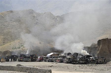 Smoke rises from burning NATO supply trucks after a Taliban attack at Torkham district