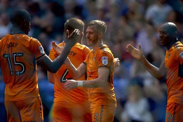 Wolves crowned Championship winners as Bolton thrashed in front of own fans