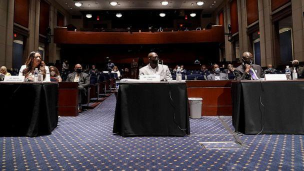 PHOTO: George Floyd's brother Philonise Floyd, civil rights attorney Benjamin Crump and Lancaster (California) City Council member Angela Underwood-Jacobs attend a House Judiciary Committee hearing in Washington. (Pool/Reuters)