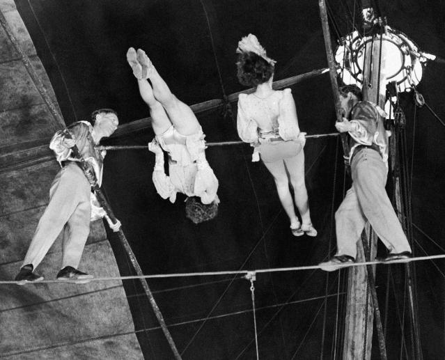 """FILE- In this April 15, 1944 photo, members of """"The Flying Wallendas,"""" famous high wire act with the Ringling Bros. and Barnum & Bailey's Circus, perform their death-defying double pinwheel in Madison Square Garden in New York. From left are Herman, Henrietta, Helen, and Karl Wallenda. On Friday, June 15, 2012, Nik Wallenda, a seventh generation """"Flying Wallenda,"""" will attempt a high-wire crossing of the Niagra Falls gorge between the United States and Canada. The event will be covered on live television. (AP Photo)"""