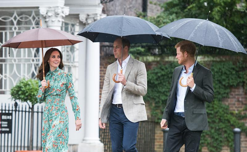 Prince William, Duke of Cambridge, Catherine, Duchess of Cambridge and Prince Harry visit The Sunken Garden at Kensington Palace on August 30, 2017 in London, England. The garden has been transformed into a White Garden dedicated in the memory of Princess Diana, mother of The Duke of Cambridge and Prince Harry. (Samir Hussein via Getty Images)