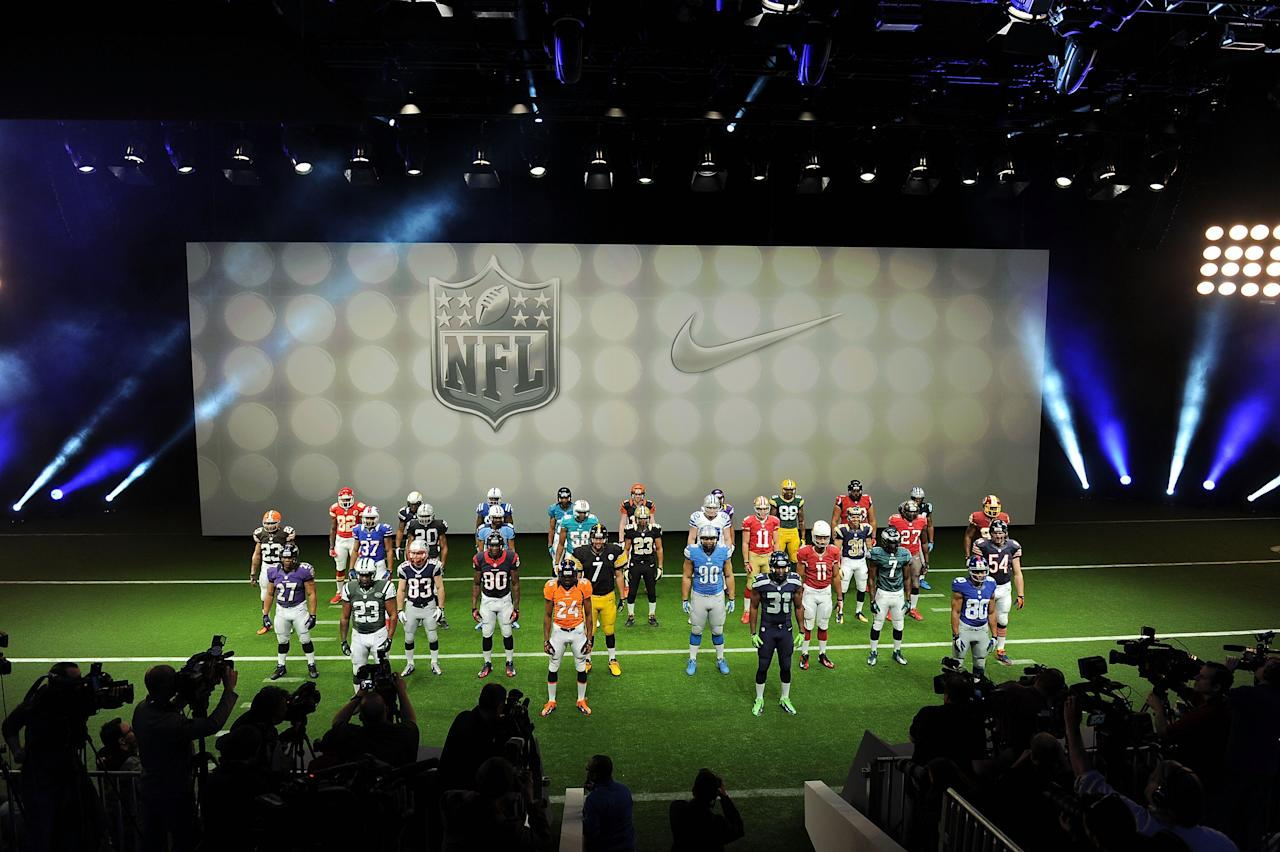 NEW YORK, NY - APRIL 03:  Nike debuts new NFL uniforms on April 3, 2012 in New York City. NFL players; AFC: Baltimore Ravens, Ray Rice / Cincinnati Bengals, Andy Dalton / Cleveland Browns, Joe Haden / Pittsburgh Steelers, Ben Roethlisberger / Houston Texans, Andre Johnson / Indianapolis Colts, Robert Mathis / Jacksonville Jaguars, Rashean Mathis / Tennessee Titans, Nate Washington / Buffalo Bills, George Wilson / Miami Dolphins, Karlos Dansby / New England Patriots, Wes Welker / New York Jets, Shonn Greene / Denver Broncos, Champ Bailey / Kansas City Chiefs, Dwayne Bowe / Oakland Raiders, Darren McFadden / San Diego Chargers, Ryan Matthews. NFC: Chicago Bears, Brian Urlacher / Detroit Lions, Ndamukong Suh / Green Bay Packers, Jermichael Finley / Minnesota Vikings, Percy Harvin / Atlanta Falcons, Justin Blalock / Caroline Panthers, Deangelo Williams / New Orleans Saints, Pierre Thomas / Tampa Bay Buccaneers, LaGarrette Blount / Dallas Cowboys, Jason Witten / New York Giants, Victor Cruz / Philadelphia Eagles, Michael Vick / Washington Redskins, Brian Orakpo / Arizona Cardinals, Larry Fitzgerald / San Francisco 49ers, Alex Smith / Seattle Seahawks, Kam Chancellor / St. Louis Rams, Cortland Finnegan  (Photo by Jason Kempin/Getty Images for Nike)